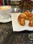Cappuccino and Croissant at La Boqueria Mercat in Barcelona, Spain